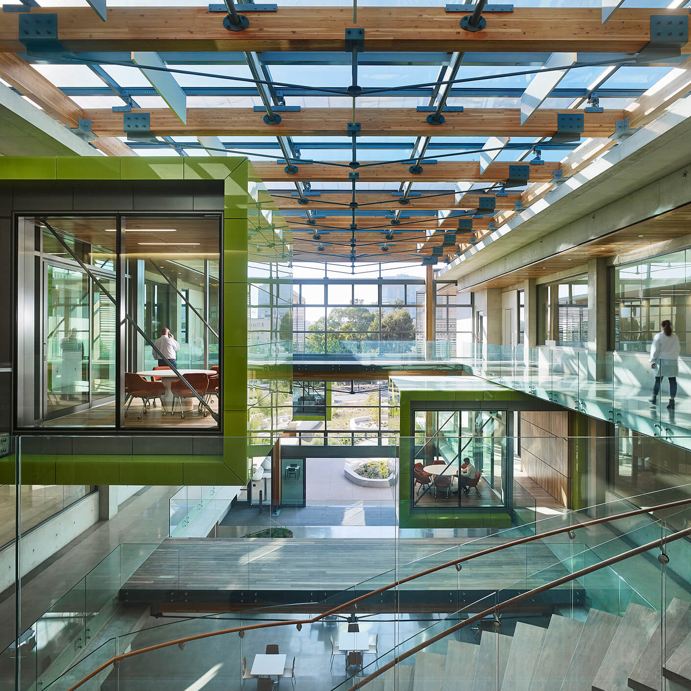 Central atrium with green meeting pods