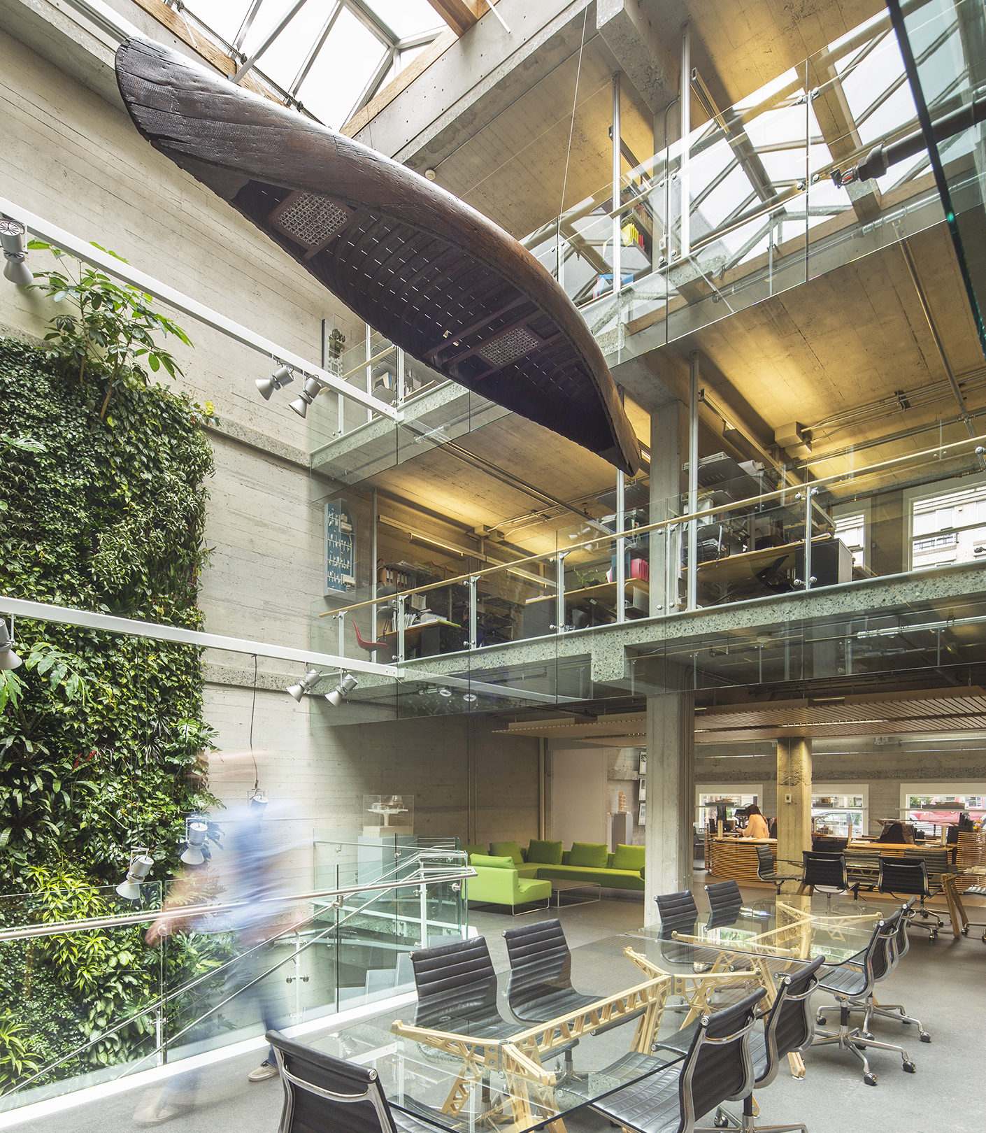 Canoe hanging in atrium of Vancouver studio