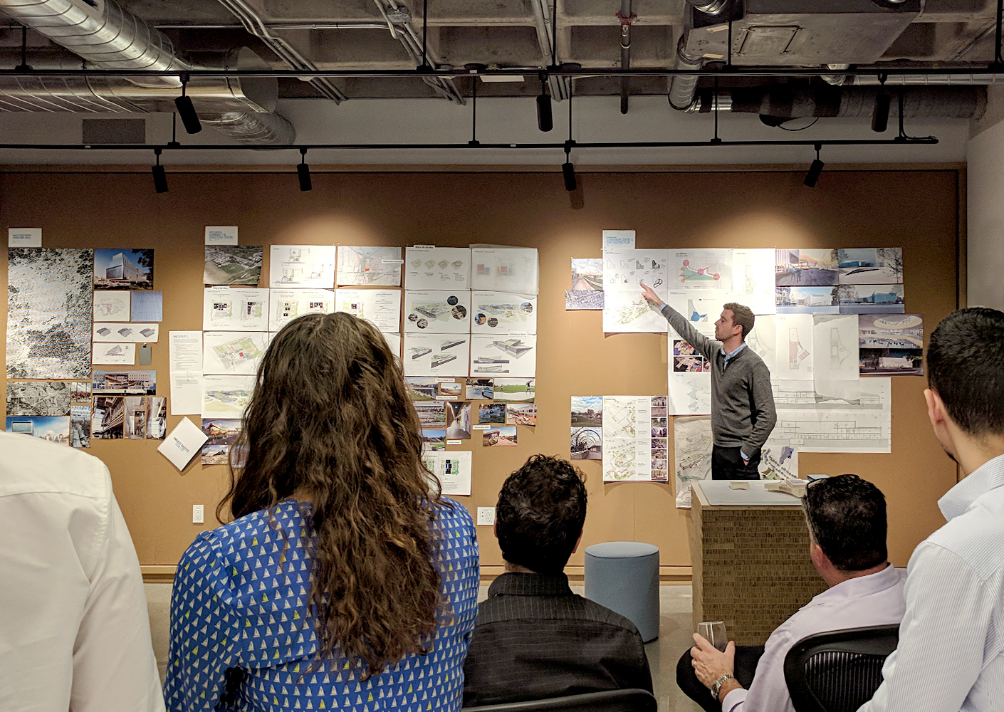 Studio members discuss projects during biweekly Design review Panel presentations